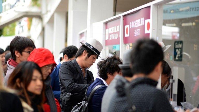 Japanese punters at Longchamp in 2014. In 2016 the JRA offered betting on a select number of international races for the first time