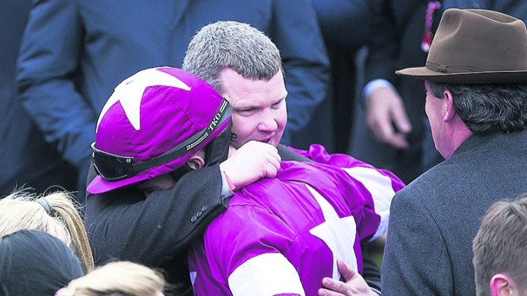 Gordon Elliott embraces Bryan Cooper after his Gold Cup success on Don Cossack