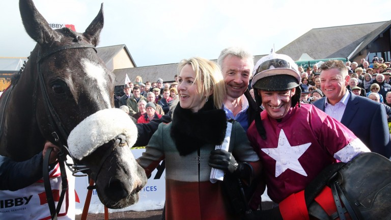 Paul Carberry celebrates with connections after his 2015 Punchestown Gold Cup success on Don Cossack