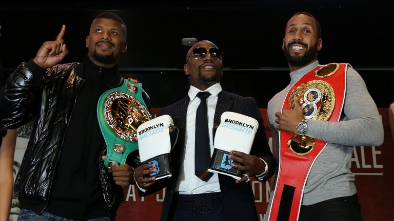 Badou Jack (left) and James DeGale pose in between Floyd Mayweather