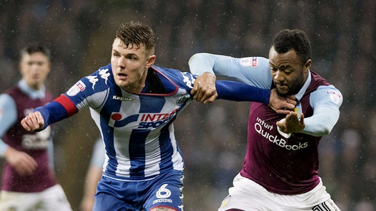 Wigan's Max Power (left) speeds away from Jordan Ayew