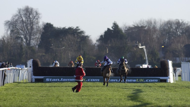Horseracing December 2004 at Kempton. Barry Geraghty and Kicking King are confronted by a man dressed as Father Christmas on the run in before winning the King George
