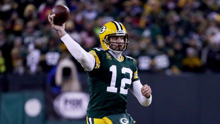 Green Bay QB Aaron Rodgers throws a pass against the Giants