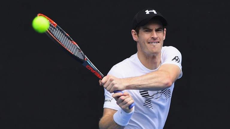 Andy Murray plays a backhand during practice