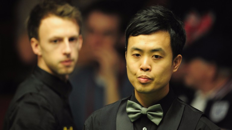 Judd Trump and Marco Fu
