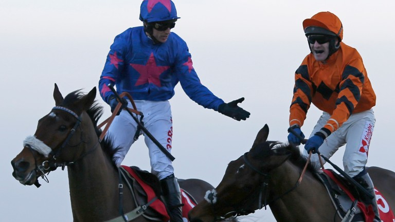 Paddy Brennan on Cue Card (left) congratulates Thistlecrack's rider Tom Scudamore after chasing him home in the King George at Kempton