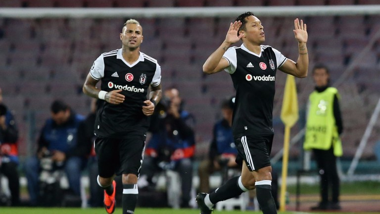 Adriano (right) celebrates a Besiktas goal