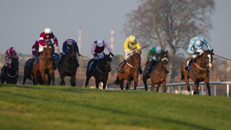 A Toi Phil (white cap, left) pounces late under Jack Kennedy to land the coral.ie Leopardstown Chase