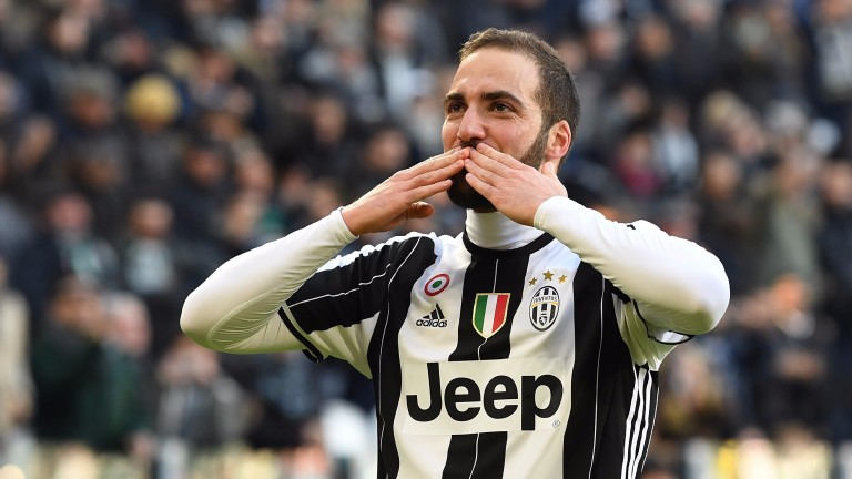 Juventus star Gonzalo Higuain celebrates a goal against Lazio