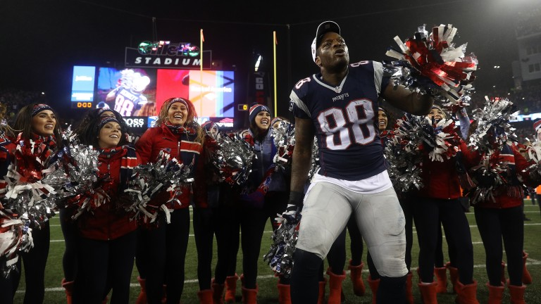 Martellus Bennett of the New England Patriots celebrates with cheerleaders