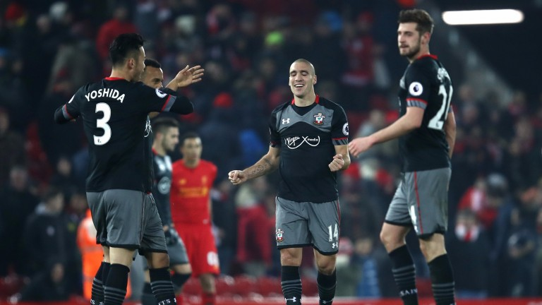 Southampton's players celebrate their win at Liverpool in the EFL Cup
