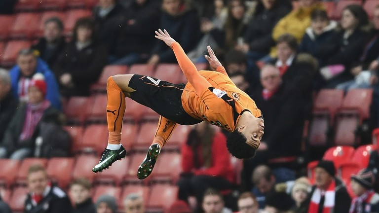 Helder Costa celebrates his goal at Stoke in acrobatic fashion