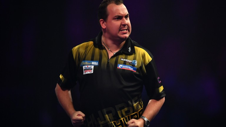 Kim Huybrechts enjoys winning a leg against James Wilson at Alexandra Palace
