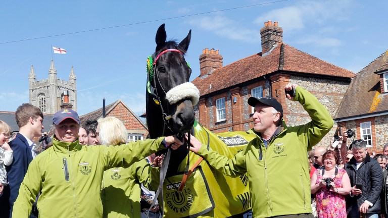 Groom Chris Jerdin (left) with Many Clouds and Oliver Sherwood after their 2015 Grand National victory
