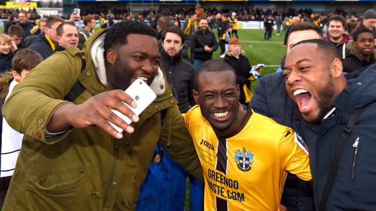 Bedsente Gomis celebrates with Sutton fans