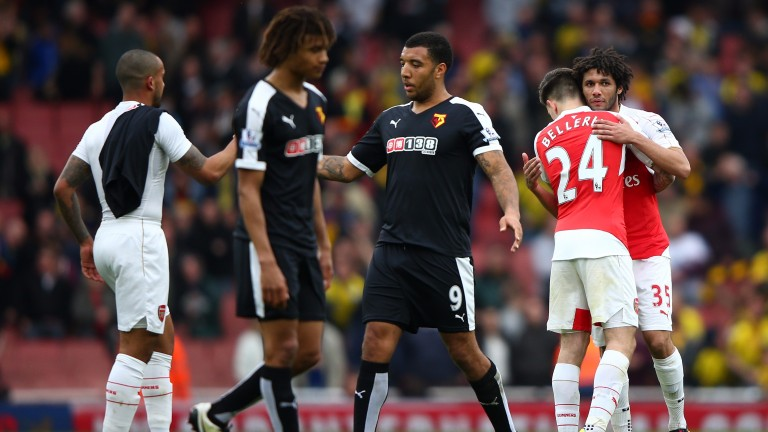 Arsenal and Watford players shake jands after last year's Emirates league game