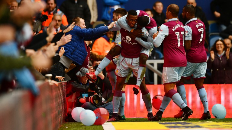 Jonathan Kodjia celebrates a goal with Aston Villa fans and players