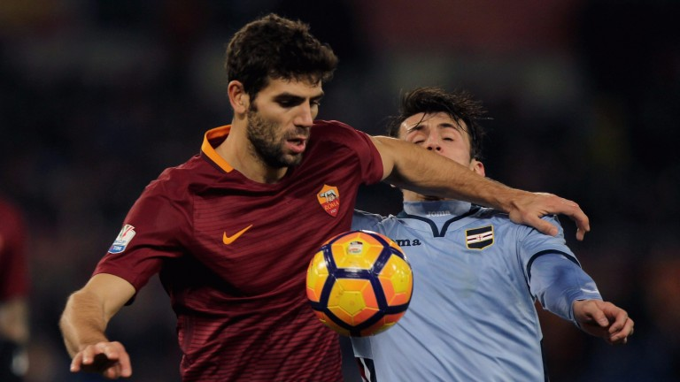 Roma's Federico Fazio challenges for the ball