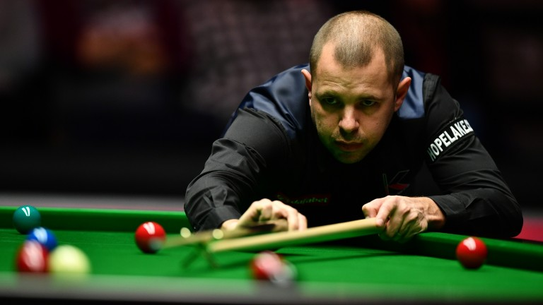 Barry Hawkins in action during his Masters semi-final against Joe Perry