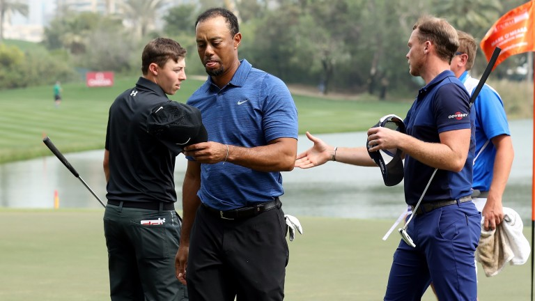 Tiger Woods and playing partners Matthew Fitzpatrick and Danny Willett shake hands after their round