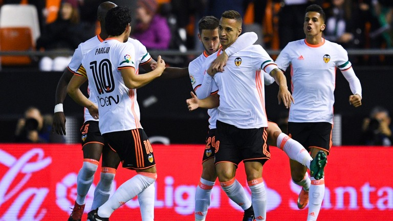 Rodrigo Moreno and Valencia celebrate a goal against Malaga