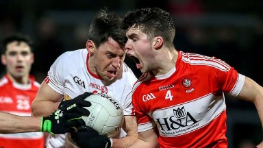 Tyrone's Mattie Donnelly (left) shields the ball against Derry's Neil Forester in the McKenna Cup final