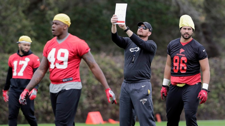 Atlanta Falcons practise under the guidance of assistant special teams coach Eric Sutulovich