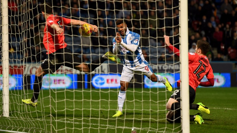 Kerching! Elias Kachunga makes it 3-1 Huddersfield against Brighton on Thursday