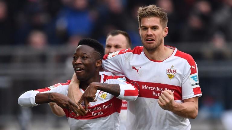 Carlos Mane of Stuttgart celebrates scoring against St Pauli with Simon Terodde