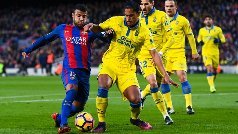 Las Palmas players queue up to make things tough for Barcelona's Rafinha Alcantara