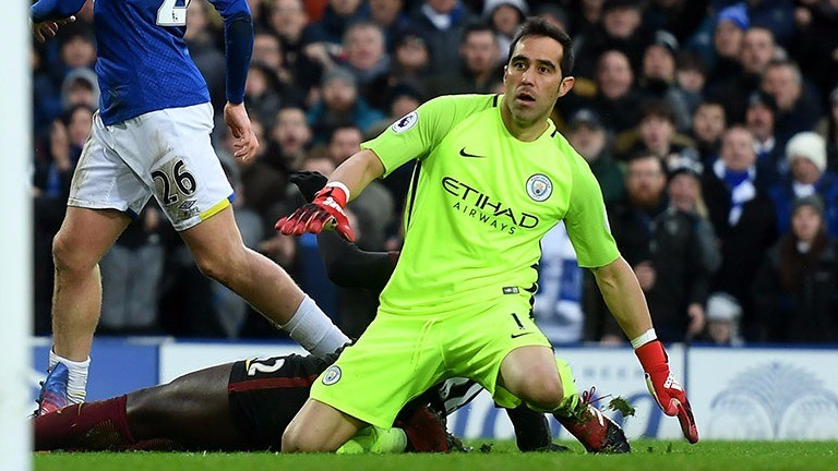 Manchester City keeper Claudio Bravo sees Everton's Tom Davies's shot go in