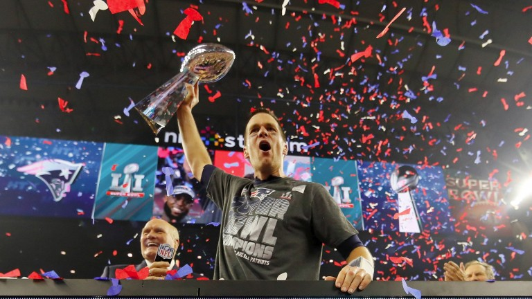 Tom Brady celebrates with the trophy following New England's Super Bowl success