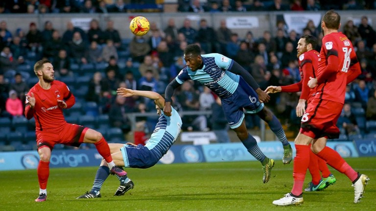 Leyton Orient can only watch as Tom Parkes of Wycombe puts one on net