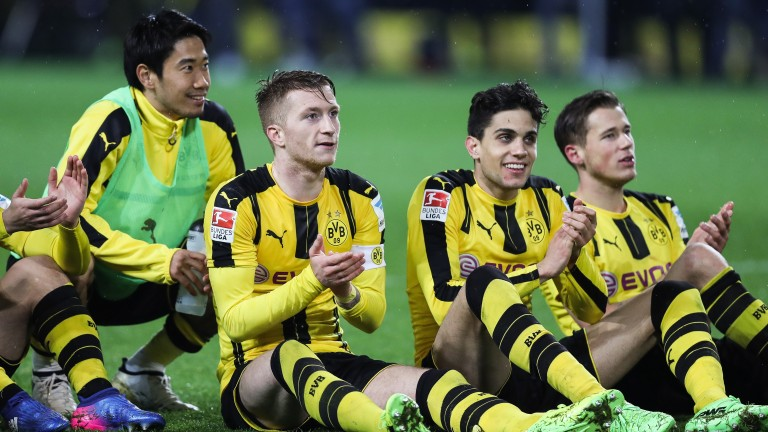 Dortmund players celebrate their goal against RB Leipzig on Saturday