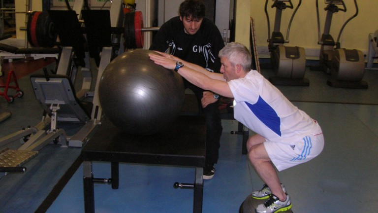 Franny Norton at work in the gym with Dr George Wilson