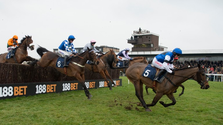 Runners in the 3m novices' handicap chase at Huntingdon jump the ditch