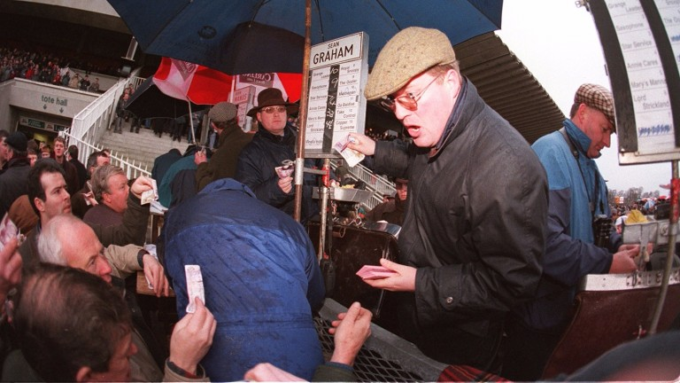 Bookmaker Brian Graham (cap, nearest camera) in action