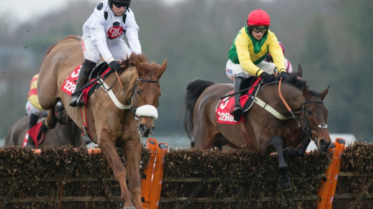 Finian's Oscar (right) jumps the second  flight with Chalonnial in the Tolworth Hurdle at Sandown