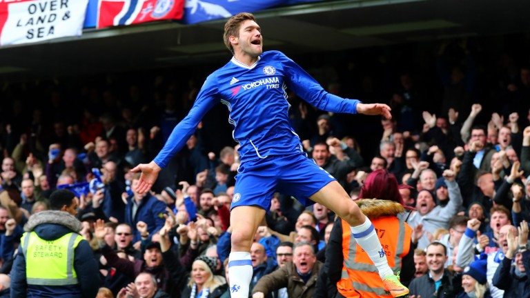 Chelsea's Marcos Alonso celebrates after scoring against Arsenal