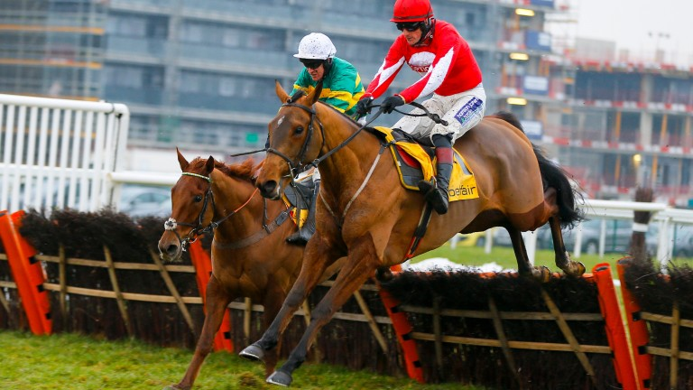 Ballyandy (right) and Sam Twiston-Davies clear the last ahead of Movewiththetimes