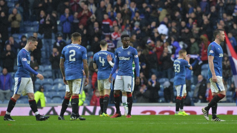 Rangers look glum after losing to Celtic