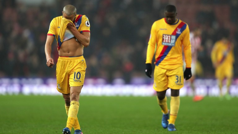 Crystal Palace trudge off the pitch after losing at Stoke