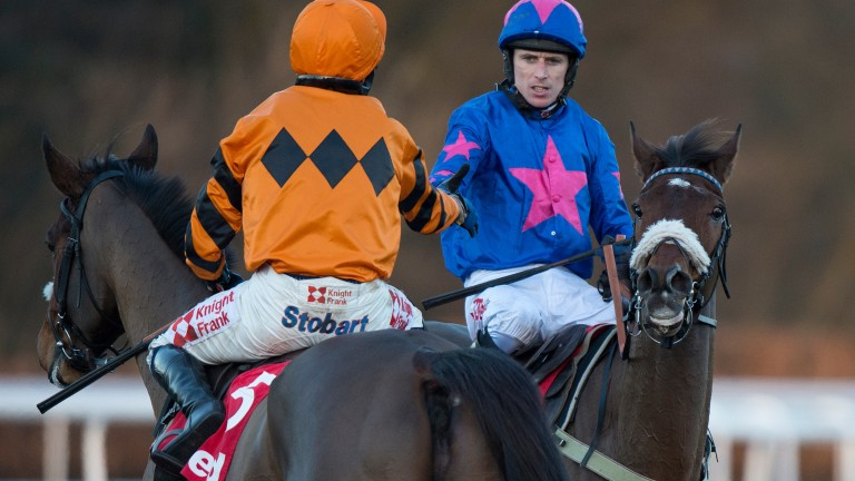 Cue Card and Paddy Brennan (blue silks) came off second best at Kempton