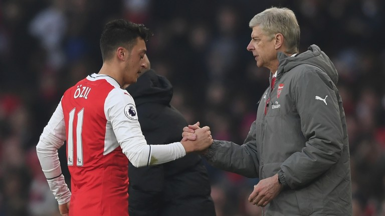 Arsenal's Mesut Ozil and Arsene Wenger