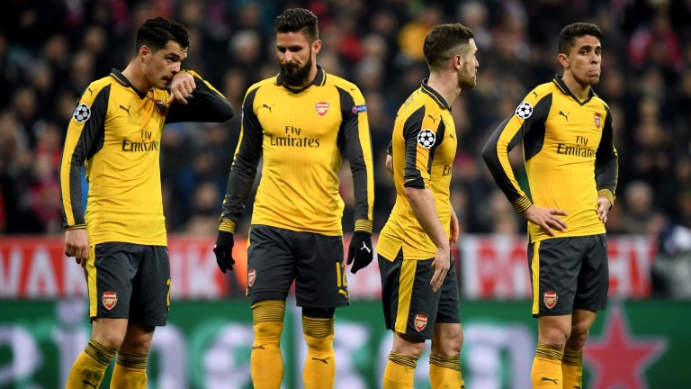 Arsenal's players look dejected during the 5-1 Champions League loss to Bayern Munich