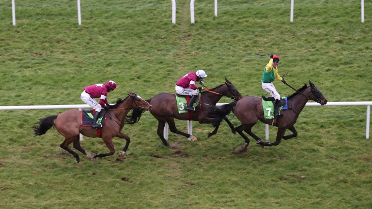 Sizing John beats Empire Of Dirt (centre) and Don Poli (left) in the Stan James Irish Gold Cup