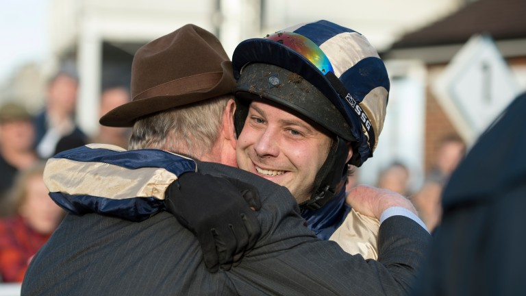 Captain Guy Disney hugs his Dad Dr John Disney after winning the Royal Artillery Gold CupSandown 17.2.17 Pic: Edward Whitaker