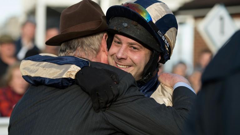 Celebration time: Guy Disney hugs his Dad John Disney after his victory on Rathlin Rose
