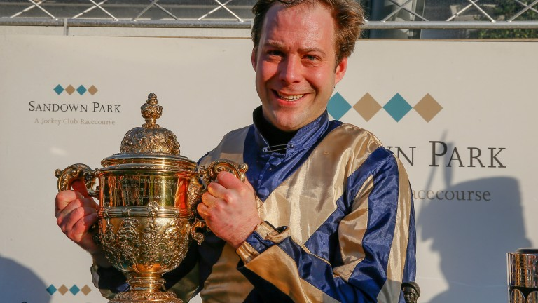 Winner all right: Captain Guy Disney holds up the trophy for winning the Royal Artillery Gold Cup
