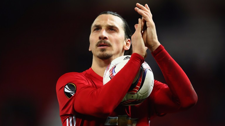 Zlatan Ibrahimovic celebrates his hat-trick against St-Etienne
